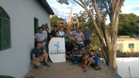 Group picture before final assembly of wooden tower, rotor, blades and tail.