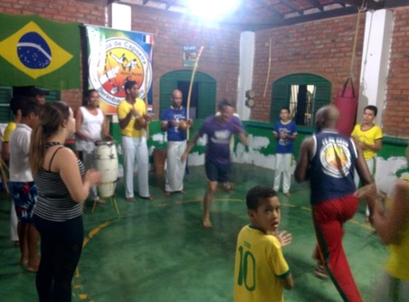 "Marco, Mark and Nick and some local students receiving a capoeira lesson from Luis, Master ""Marreta"", the owner of the school."